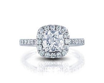 Custom Made Halo Engagement Ring with 0.90cts of diamonds F+/VS-SI and with 1ct Round Diamond Stimulant as a center stone.