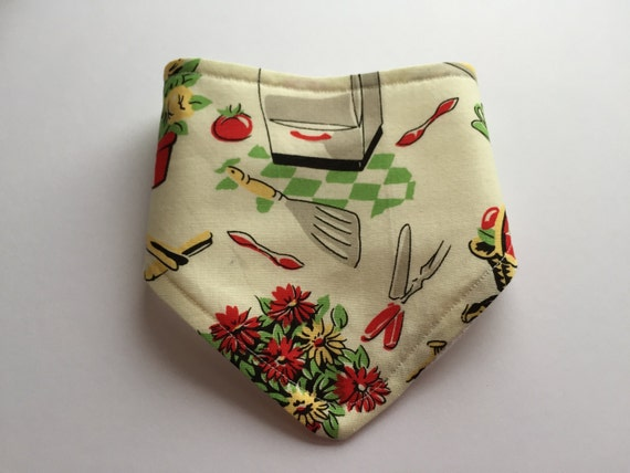 New born baby bandana bib with 50's retro kitchen print. Hand made out of soft cotton, waffle cotton and colour snaps.