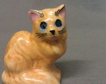Yellow Tan Beige Cat with Pink Ears and Blue Eyes Cat Figurine