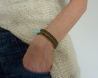 Jet and gold beads and leather wrap bracelet