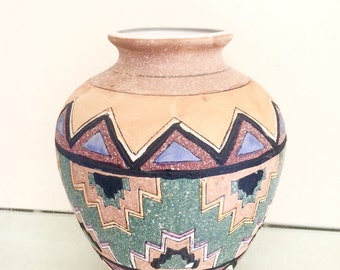 Old ceramic vase decorated by hand