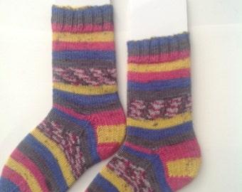 Blue striped socks, self striping fairisle pattern. Handknit blue ,gold gray and pink socks.