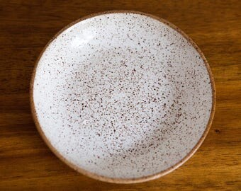 handmade speckled clay salad bowl with white glazed interior