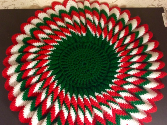 Small red and green crocheted Christmas tree skirt
