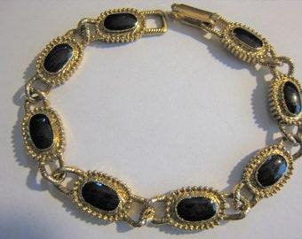 Gold Tone W/ Black Accents Bracelet