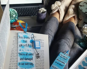 Holding up the universe bookmark - Handmade