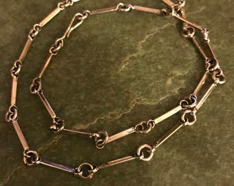 Hand made sterling silver necklace with stamped design on clasp
