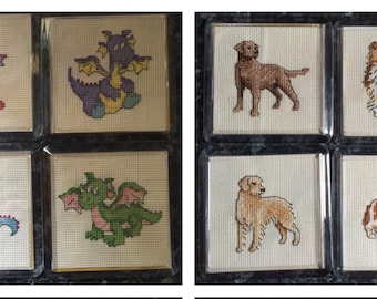 Various cross stitch coasters . All you need to do is pick one .