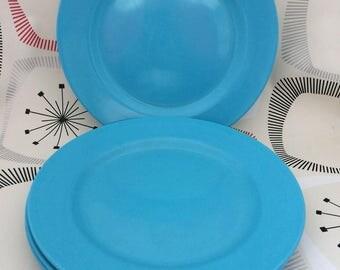 Four Turquoise Melamine Side Plates