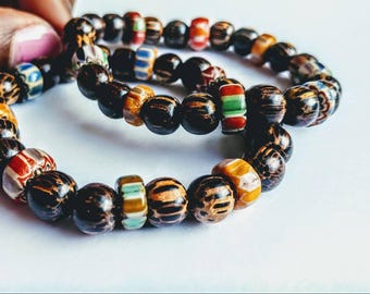 Stretch,wood bracelets with Nepalese beads.