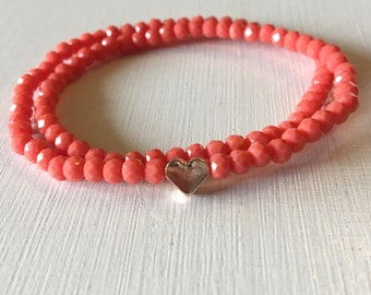 Faceted crystal glass beads bracelet in pink with rose gold gilded heart
