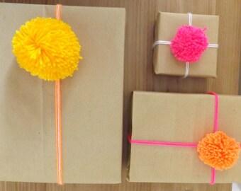 Pom Pom Gift Wrap set, 2 sheets kraft wrap, 3 pom poms, 3 lengths of yarn...................FREE UK SHIPPING