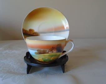 Noritake hand painted cup and  saucer sunset scene