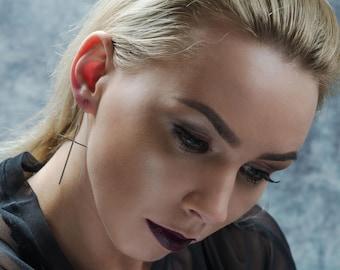 Cross pull through earrings