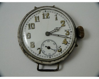 Rare over 100 years old first wrist watch huge size 40mm trench watch just serviced nice antique movement runs fine must see