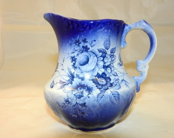 Blue and white ceramic milk jug