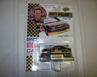 1992 Road Champs NASCAR #2 Pontiac Grand Prix RUSTY WALLACE Mobil Gas Sponsor 1 64 Scale Die Cast Unopened Mirrored Display Stand