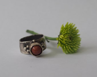 Large handmade silver goldstone ring.