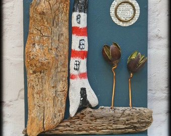 Driftwood key racks. Curvy lighthouses, rugged boats, rocky cliffs and white washed cottages keep your keys safe or display precious finds