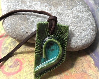 Blue and turquoise clay pendant