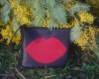 Black and red leather pouch