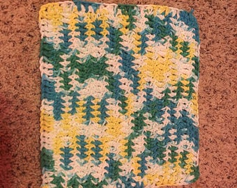 Blue, green, and yellow crochetes dish cloth