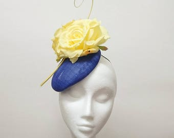 Royal blue pillbox with yellow roses