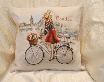 Decorative pillow, Tapestry pillow  18 x 18 inches, Beautiful Girl imagery , Girl in London on bicycle with a basket of flowers