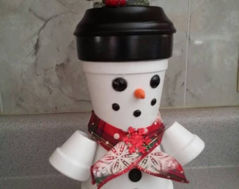 Clay pot snowman candy dish