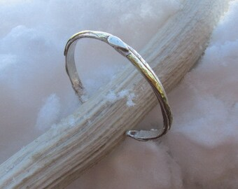 Sterling bronze cuff.