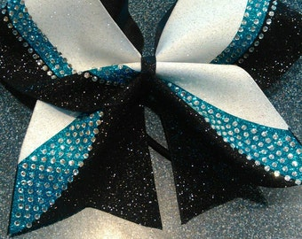 Teal, black and white rhinestones cheer bow