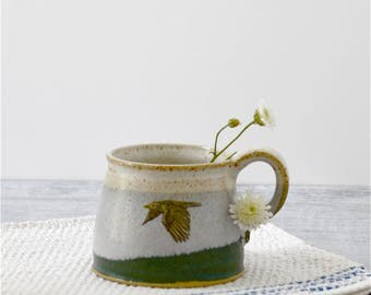 Rustic ceramic mug with flying seagull glazed in moss green to misty blue to creamy white - handmade stoneware pottery