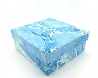 Sky blue hand marbled paper box with lavender coloured lining