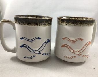 Pair of Vintage Stoneware Blue and Pink Seagull Mugs
