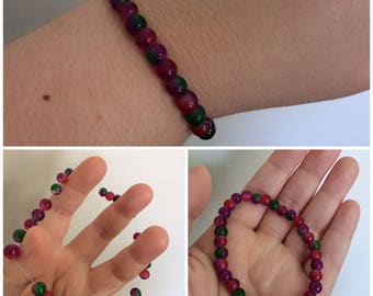 Purple, Red, Magenta, and Green Beaded Bracelet