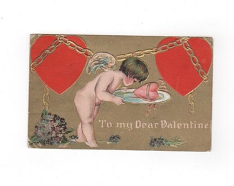 Antique Valentine's day card postcard. Cupid with heart on a platter. To My Dear Valentine. 1910 postmark. vintage collectible ephemera