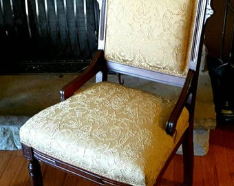 Newly reupholstered Eastlake Chairs in a neutral taupe brocade