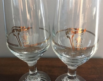 Two vintage torch wine glasses from Calgary Winter Olympics 1988