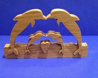 Family of four, dolphin family. Solid wood dolphins lovely present for Birthdays, 5th wedding anniversaries, mothers day