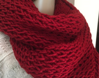 Lovely soft knitted burgundy infinity scarf, wraps around the neck loosely twice. Goes well with any outfit.
