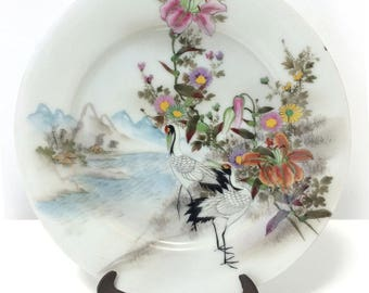 Vintage Asian beautifully decorated plate, Storks amidst day lilies, flowers, mountains, village, signed