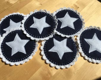 Navy and cotton coasters made from felt and crochet. A perfect blend of retro and modern.