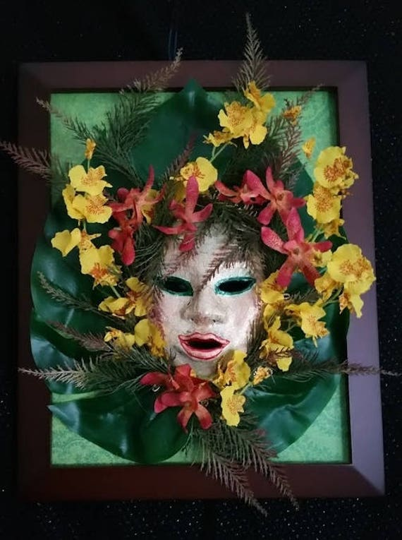 Flower Child is Original, One of a Kind, Venetian Style Mask, made with Orchids, Leaves, Paper Mache, set in a Shadow Box, depicts the 60's
