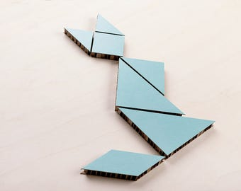 Cardboard tangram puzzle / game in mint-green color. Great wall decoration for your home!