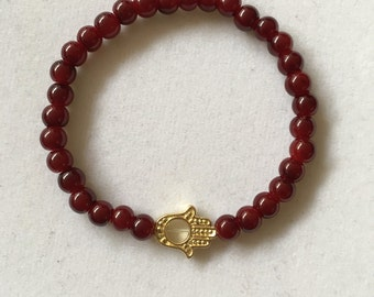 Gold hamsa and ruby red bead bracelet