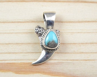 Sterling Native American Navajo silver, turquoise and bear claw. Man.