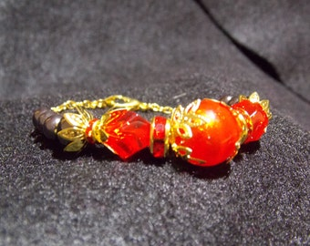 Bracelet red black and gold