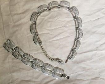 Silver necklace and bracelet set.