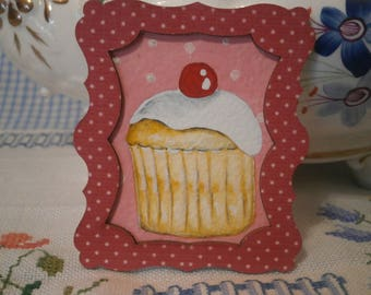 Miniature water colour painting of a cupcake