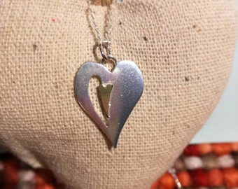 Silver and brass layered heart pendant